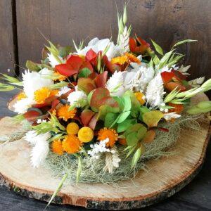 base tronco con flores preservadas